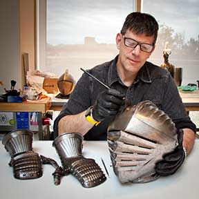 Arms and Armor Conservator Bill MacMillan treating a 16th c. helmet