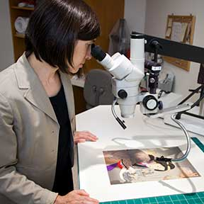 Paper Conservator Eliza Spaulding examining a 19th c. Japanese print through a stereomicroscope