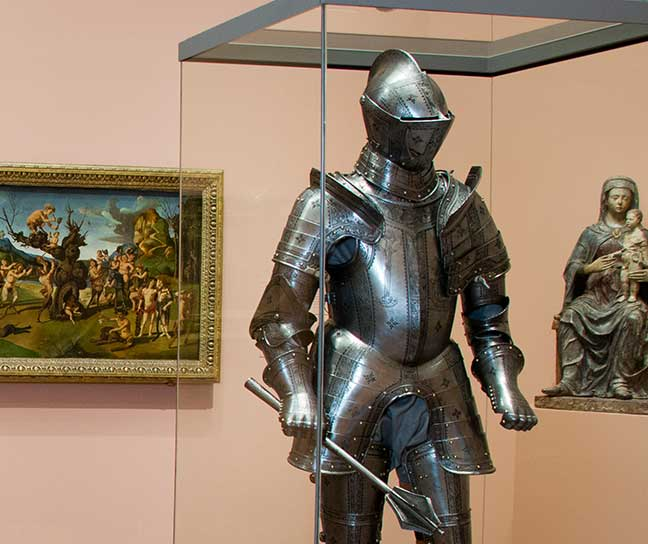 A suit of armor on display in a painting gallery at WAM
