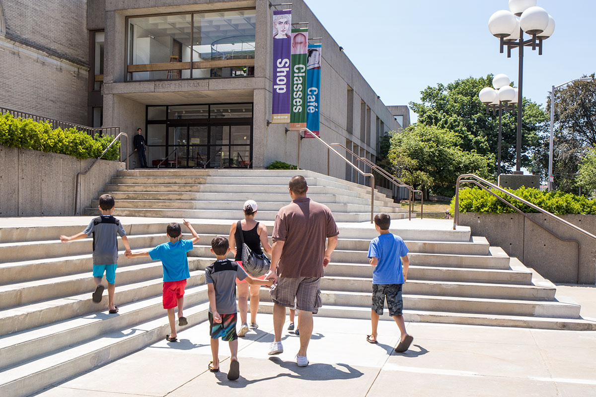 A family walking up the steps at the WAM Lancaster Street entrance